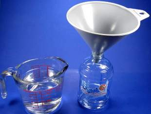 2 cups of distilled water, an 18 oz water bottle and a funnel