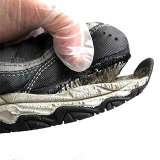 Sole separated from upper on a pair of running shoes.